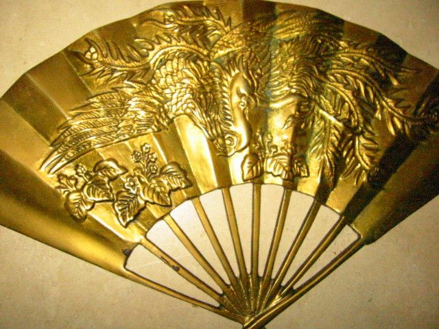 """Genuine Solid Brass, Beautiful fan, Made in Taiwan"", Republic of China. floral, dragon, phoenix relief,chasing & engraving. very good condition. 7"" h. x 11.5"" w. quite heavy, decorative."