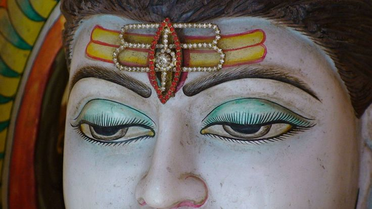 The extra eye represents the wisdom and insight that Shiva has. It is also believed to be the source of his untamed energy. The vibhuti are three lines drawn horizontally across the forehead in white ash. They represent Shiva's all-pervading nature, his superhuman power and wealth. Also, they cover up his powerful third eye. Followers of Shiva often draw vibhuti lines across their forehead.