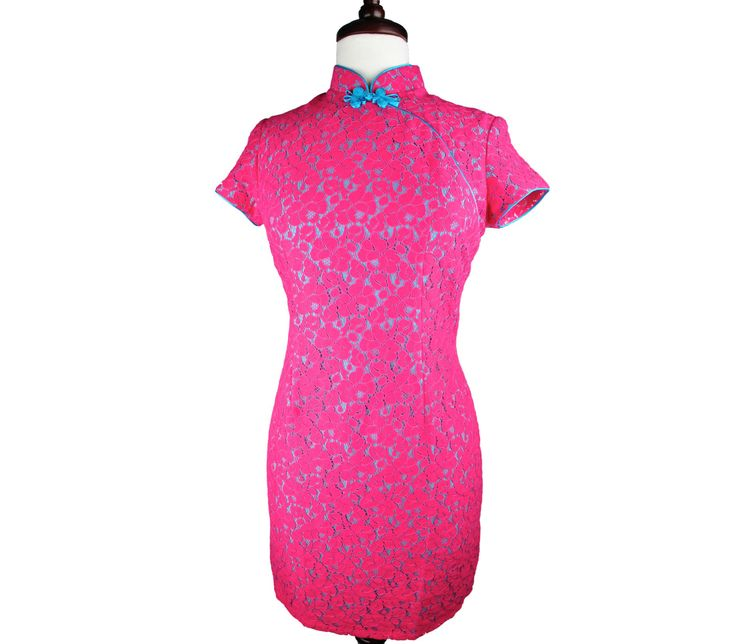 Girly with a capital G, this shocking pink traditional qipao comes in full lace with striking blue ribbons…perfect for days when you feel like standing out in a crowd.