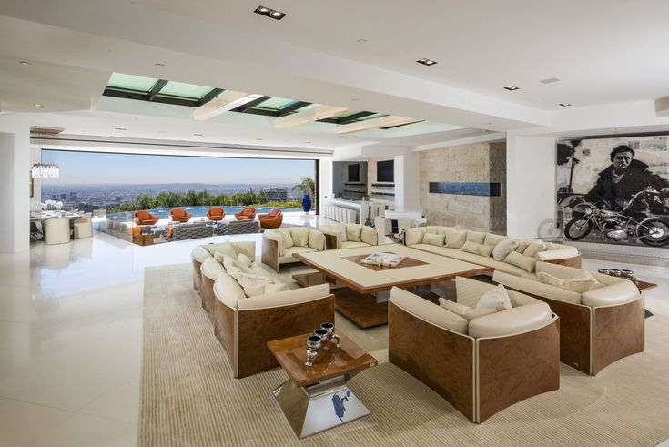The Creator Of Minecraft Outbid Beyonce And Jay Z For This Bonkers $70 Million LA Mansion - The living room has a skylight and looks out over the horizon.