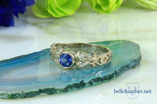 Diana Loveknot ring with 0.70 ct blue Sapphire and 4 diamonds Retail $1800 USD