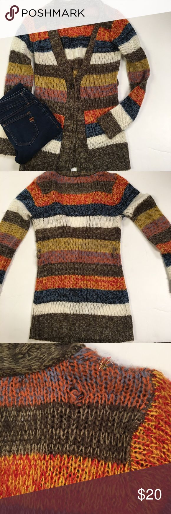 "Colorful Striped Long Cardigan Sweater This is a casual and mid-weight striped Cardigan sweater. Blue, orange, yellow, brown, Ivory, and a smidge of gray hue thrown in. There are two things wrong with it. There used to be a tie, which has gone missing, and there is a small snag in the upper right shoulder, as shown in the photos. Price is reflective of that. Single button mid way down. 100% acrylic. Very soft. Machine washable. 34"" from shoulder to bottom hem. Ashley Sweaters Cardigans"