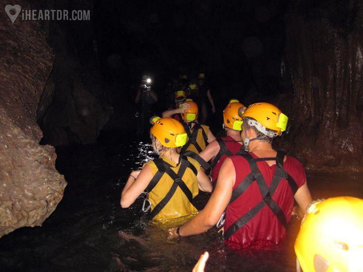 Group waist deep in an underground river