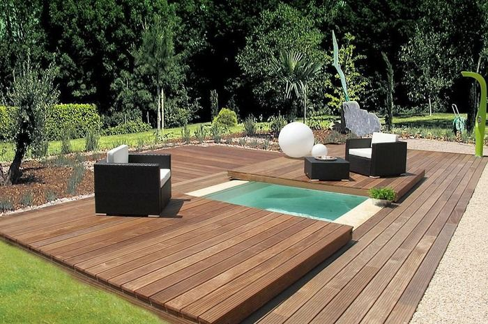 inground swimming pool-spa with wood cover