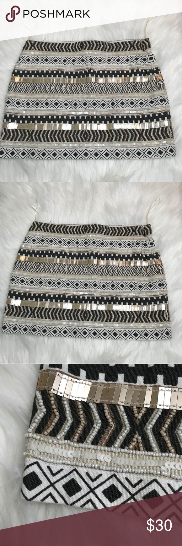 "Zara Trafaluc Sequin Aztec Mini Skirt Side zippered, Lined Sequined Aztec Style Zara Mini Skirt. Some sequins/beads missing as noted in photos but due to design of skirt not noticeable while wearing. Look at photos for wear. Besides that skirt is in great condition with no tears or stains. Waist 15"", length 13"" Zara Skirts Mini"