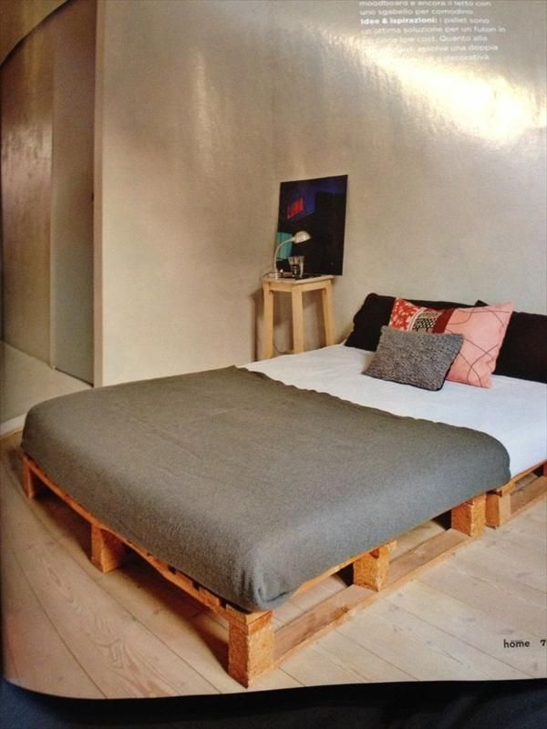 "DIY Pallet Bed...pallets ""lifted"" by blocks for more height...nicer than right on the floor...easier on older backs and knees and makes room for underbed storage"