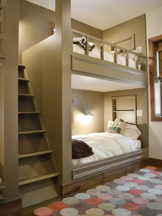 Guest bedroom with a queen bed on bottom.  Bunk beds.