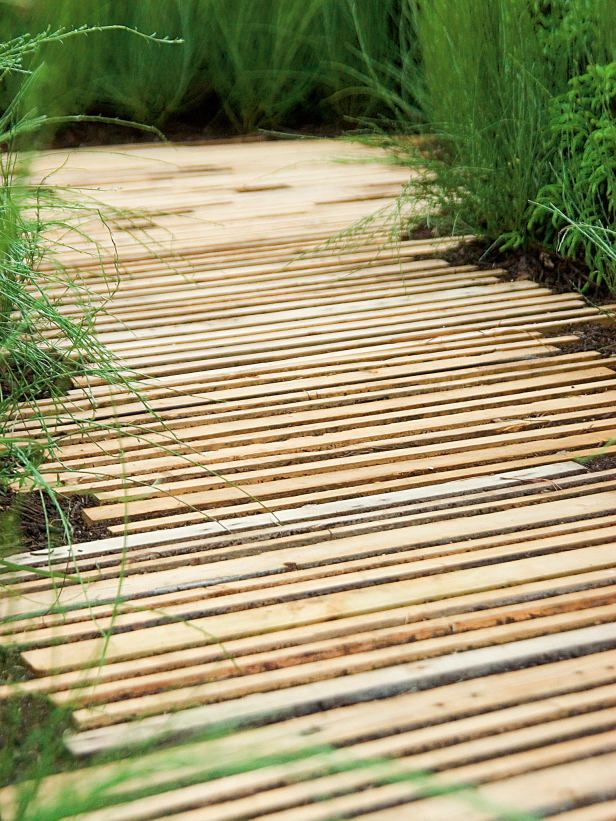 Wood Strips Path Effective with Ornamental Grasses Narrow wood strips make an effective path when placed along grasses but could be slippery when wet.