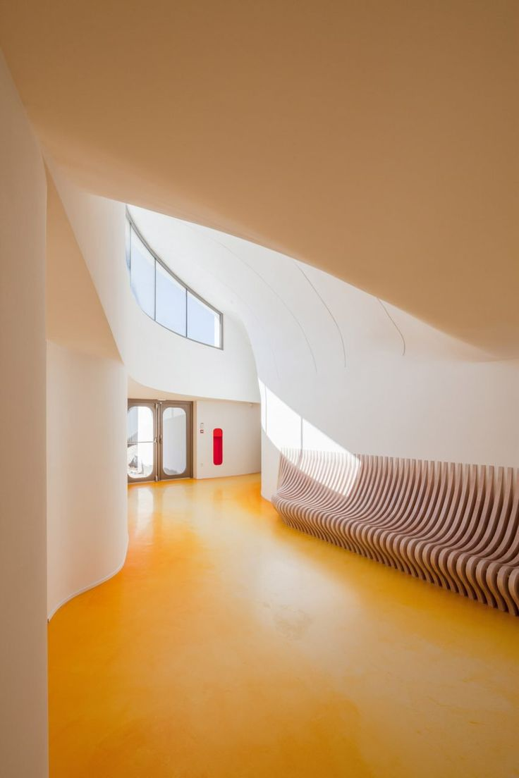 Scooped rooflights and sinuous forms define Strasbourg tennis clubhouse by Paul Le Quernec