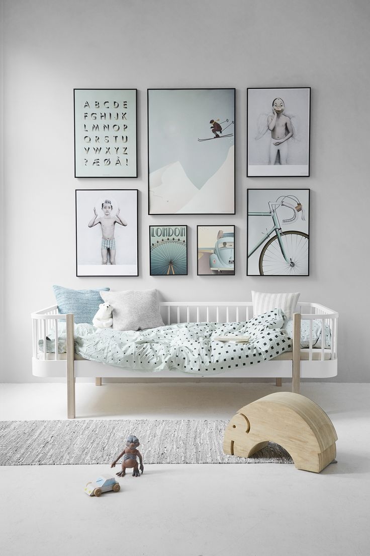 Love the toddler bed and color palette, but some of the artwork looks a bit intense for a kid's room. Overall, a lovely space!