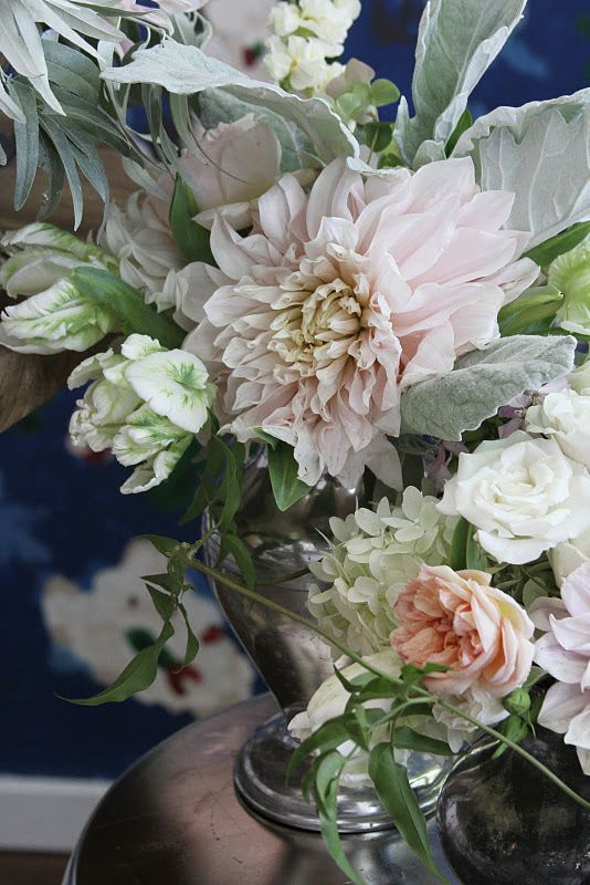 Blush and silver summer centerpiece by Sarah Winward, dahlia, parrot tulip, garden rose, jasmine vine, hydrangea, dusty miller