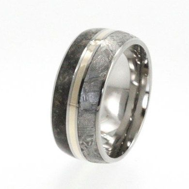$1,167.00, via Etsy.  this ring is made of titanium, dinosaur bone, and _meteorite_.  jesus that's cool.
