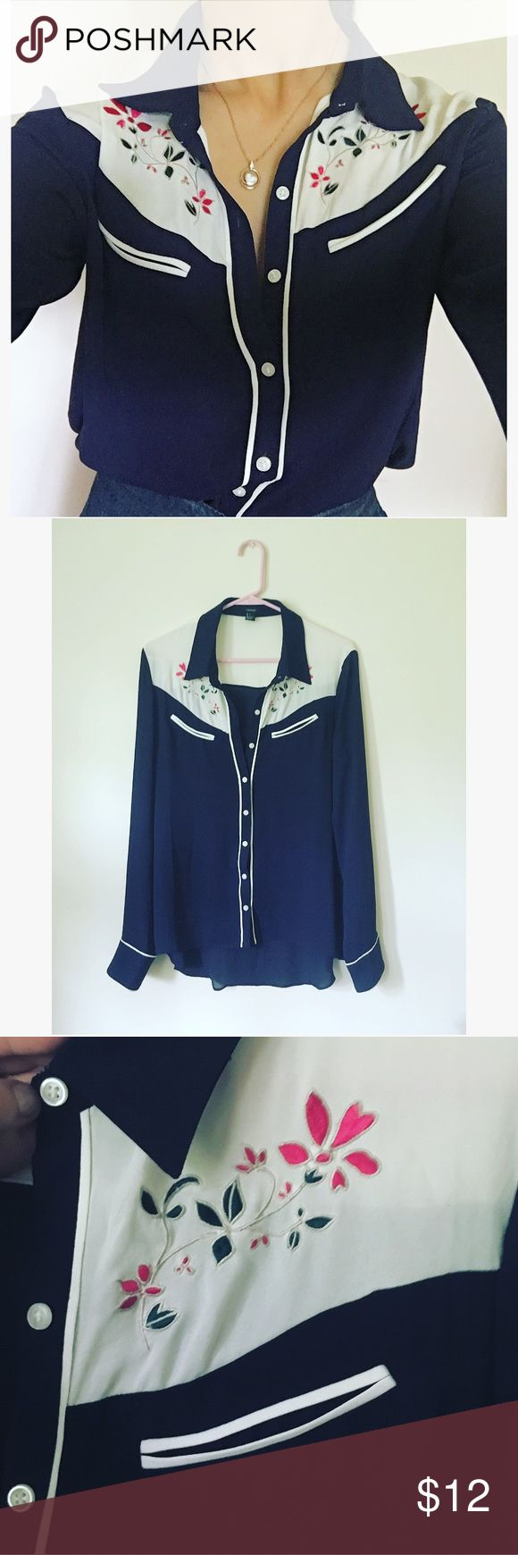 Embroidered blue and white blouse This blouse is gauzy but not sheer, and has blue and white paneling with embroidered pink flowers under the collar. Button up front and long sleeves, looks great ticket into a high waisted pair of jeans. Worn once Forever 21 Tops Blouses