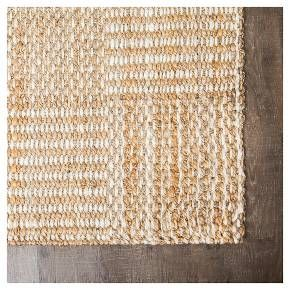 This all-natural jute area rug features a subtle, checkerboard pattern in a chunky weave that adds texture, visual interest, and durable floor protection to any room in your home. Creamy ivory and earthy tan and gold fibers play nicely as a neutral in coastal, minimal, traditional, and modern décor styles alike. Handloom-woven by skilled artisans in India, this rug is GoodWeave® certified as ethically produced with fair labor practices. It also features sustainably farmed ju...