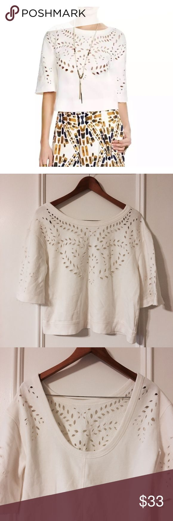 Free people eyelet cropped top Free people crumpet top. New with tag. Suggested retail price: $108 ivory color. Sweatshirt material, cropped top with Scoop back. Elbow length sleeves. Very cute but Scoop in the back was too deep for me. Not my style. Free People Tops Crop Tops