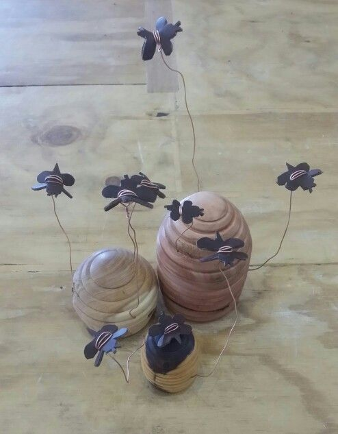 Turned bee skeps (sandalwood, eucalypt and mulga) with copper and leather bees - Luke de Hoog