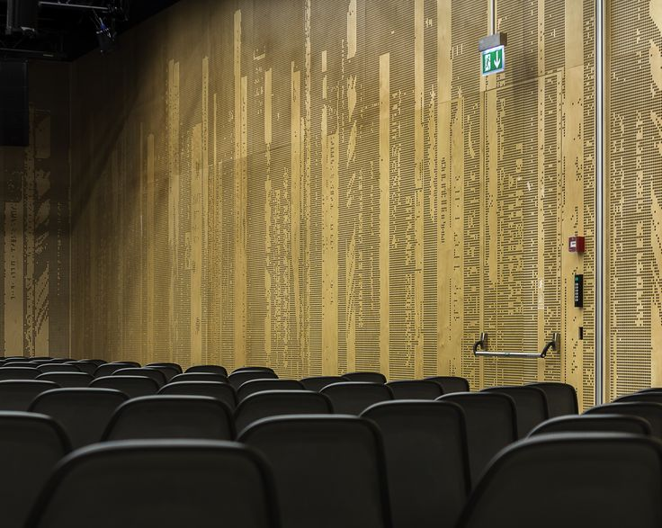 The surface texture of the doors that was delivered for Dokk1 in Aarhus, Denmark.   They are mounted inside the concert hall, and are used for secondary purposes as acoustic elements and fire exits.   They almost blend into the wall.   Photos by www.ditlevart.dk Doors by www.vahle.dk  #shlarchitects #brunohansenfurniture #danishdesign #danisharchitecture #concerthall #acoustics #internaldoors #dokk1 #aarhus