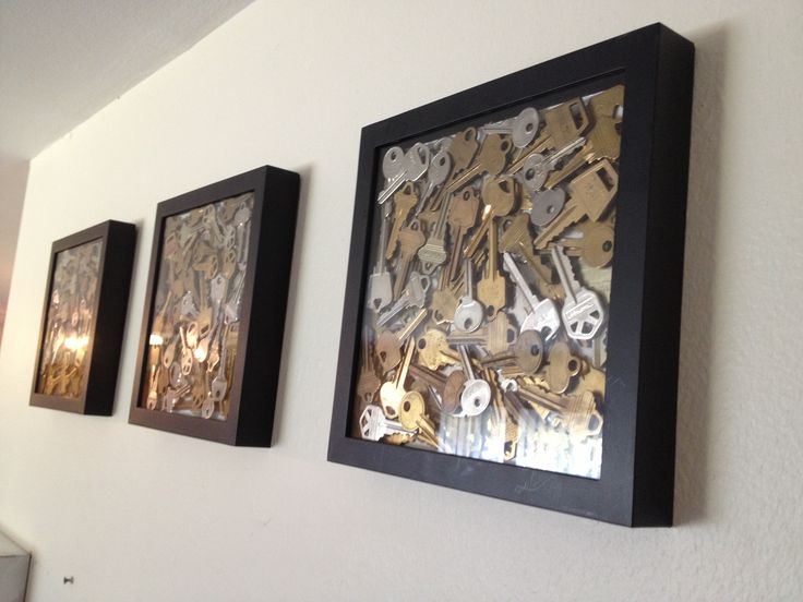 As a manager of several apartment complexes I had A LOT of old keys. I even contemplated throwing them out, but I didn't.  I wanted to incorporate them somehow with my model apartment/leasing office makeover, this is what I came up with!  The best part is it barely cost anything! The 3 pk of shadow boxes I got BOGO free when I purchased a frame at Michaels! People that come into my office LOVE it! So proud of my project! =)  I figure I should mention that since the keys are heavy that I did…