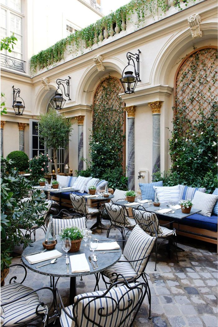 The garden at Ralph's Restaurant is a favorite spot in Paris and a must-see for any visit #garden #travel Adore the banquettes Outdoors! Nobody does that!