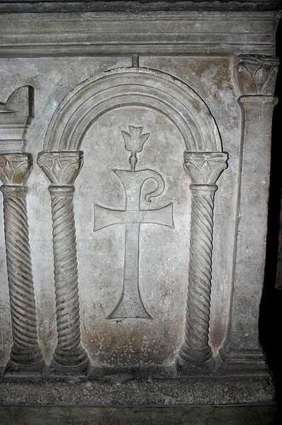 Detail (Chi Rho sided by two columns and topped by a dove) of a 3rd century AD paleochristian sarcophagus in the Cappella di sant'Aquilino chapel in the Basilica di San Lorenzo Maggiore in Milan, Italy