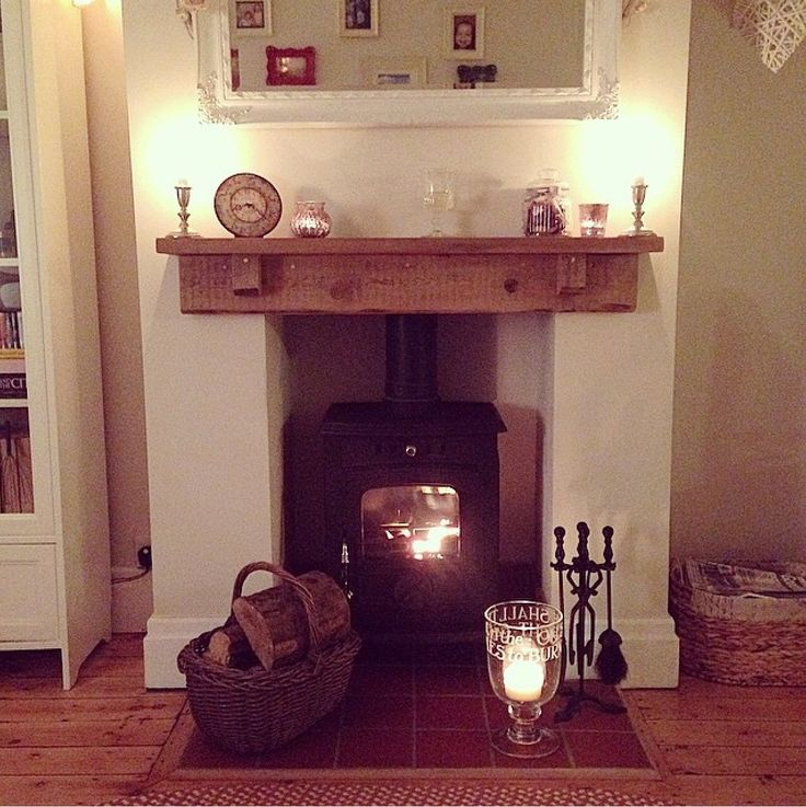 Log burner stove with reclaimed wooden shelf. Insure clearance from log burner to shelf is big enough.