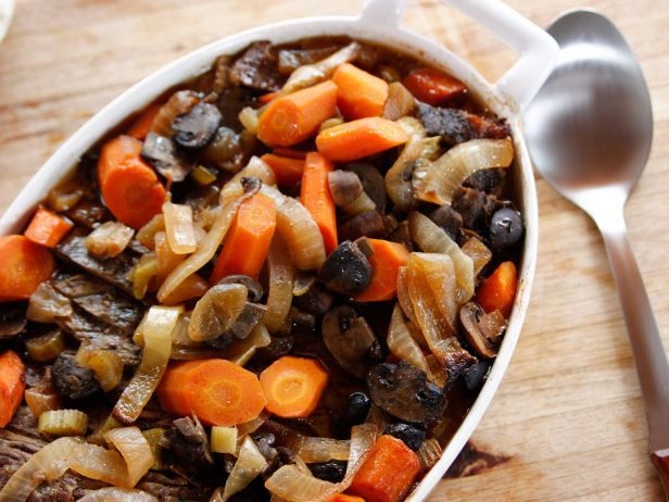 Beth's Brisket : Ree cooks vegetables such as carrots and onions with the brisket, guaranteeing over-the-top flavor.