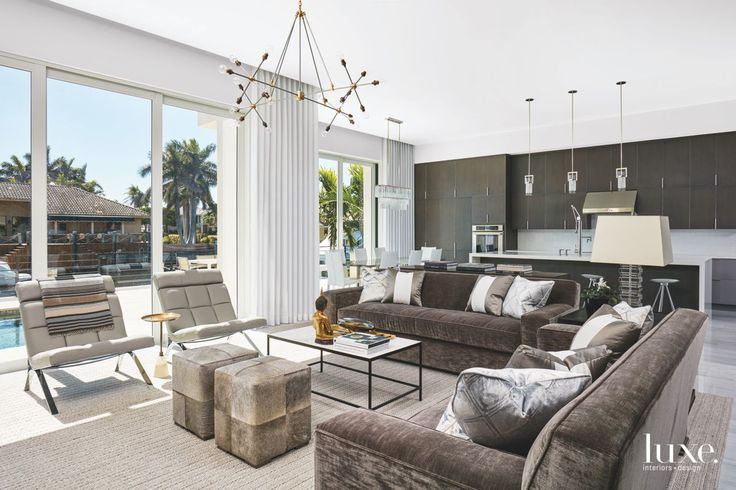 A design team creates a tropical modern home off the Intracoastal infused with a palette of charcoal, gray and white, adding glints of gold for contrast and warmth.