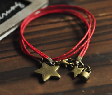two circles bracelet,retro stars pendant bracelet,red wax rope bracelet. via Etsy.