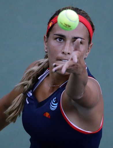 Monica Puig, of Puerto Rico, serves to Zheng Saisai, of China,during the first round of the U.S. Open tennis tournament, Monday, Aug. 29, 2016, in New York. (AP P