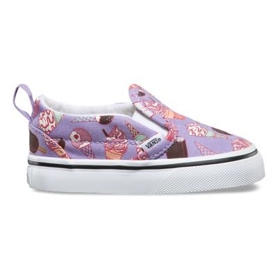 The Glitter Ice Cream Slip-On V features low profile slip-on canvas uppers with an allover ice cream print, elastic side accents, signature rubber waffle outsoles, and heel pulls for an easy on-and-off fit.