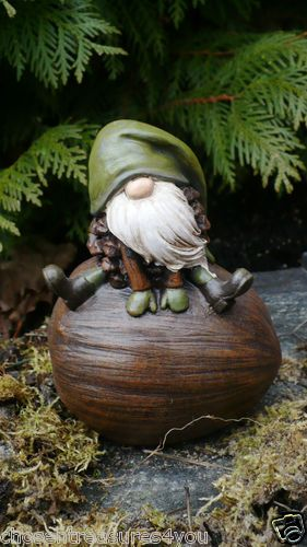 who would have thought that gnomes could be this cute? I just love this acorn gnome series. We have bird feeders, gnomes on animals, chimes, etc.
