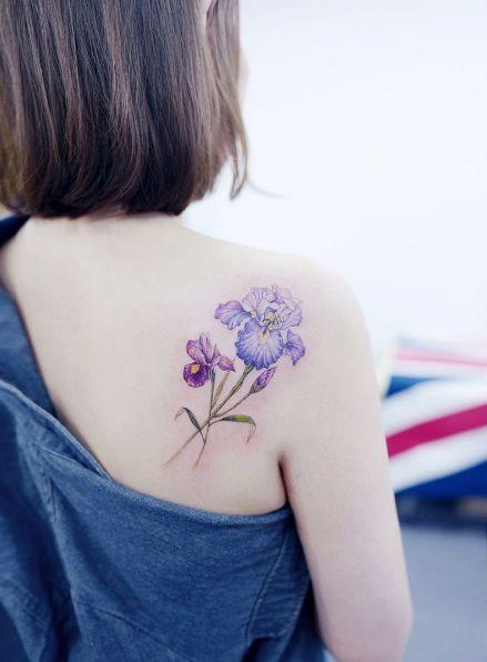 Purple iris on back shoulder by Tattooist Banul