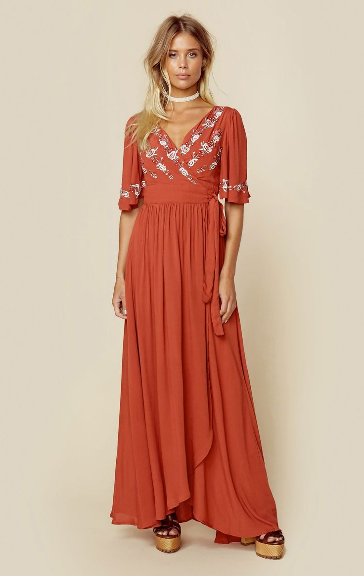 The Rahi Cali Zahara Wrap Dress features three quarter length billowy sleeves…