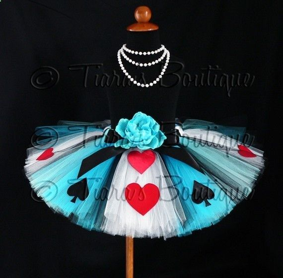 Id love to make this alice in wonderland no sew tutu. Loop tie tulle strips to measured elastic band and add felt shapes.