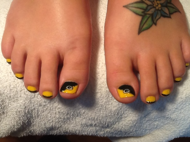 Green Bay Packer toes!!! Done by Carley Kohler at Kapreli Salon and Spa!!! Come get yours!! :)