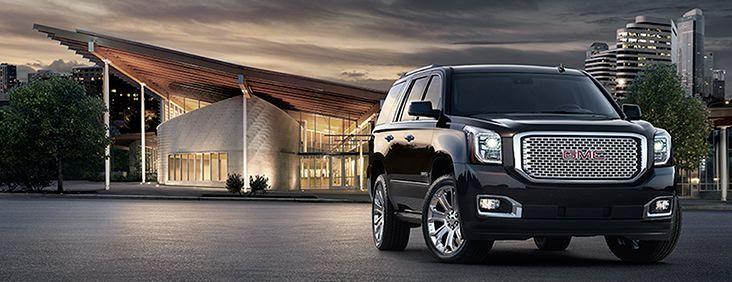 2015 Yukon Denali full size luxury SUV exterior featuring a premium and sleek design.