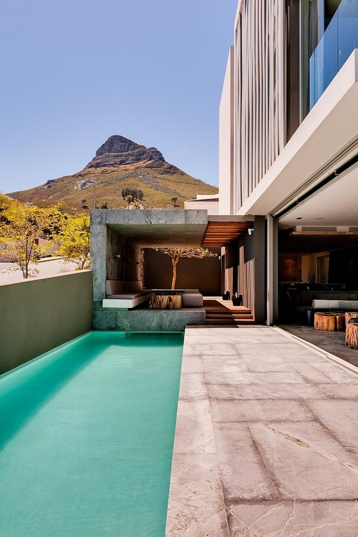 The luxury POD boutique hotel offers breathtaking views of the deep blue Atlantic ocean and sits right across from the famous Camps Bay beach, Cape Town.