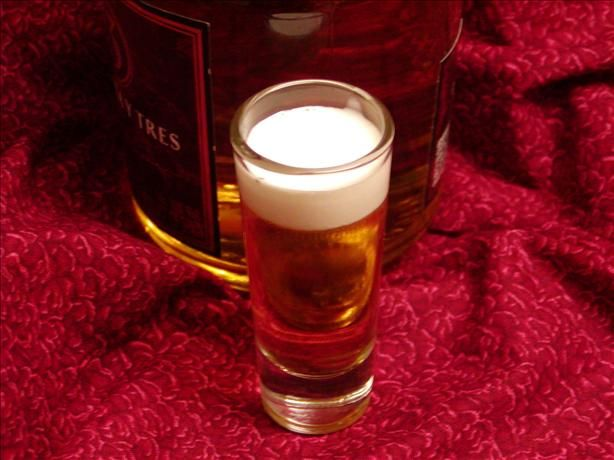 """Mini Beer (some places call it """"Little Beer"""") - shot of Licor 43 topped with heavy cream.  Tastes like a melted Vernor's Float with a great big kick.  No other shot recipes will ever be needed.  EVER :o)"""