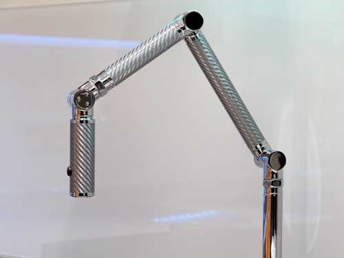 Kohler articulated mixer and jet spray tap.