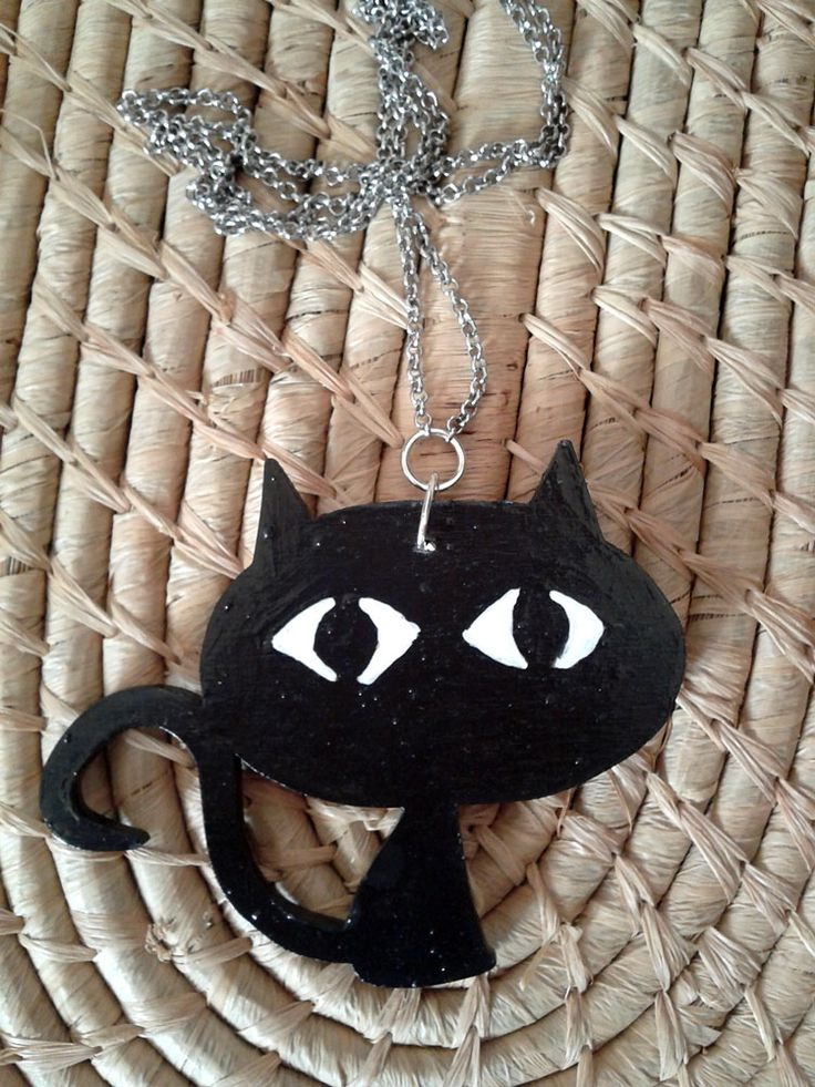 Wooden black cat with long chain.