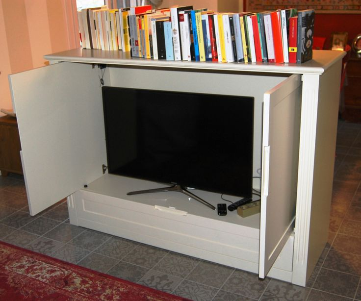 "Tv cabinet ""ALMA"" with wheels; reentrant doors and drawers with perimeter frame, handle excavated in wood. On the back closing panel there is a box (of about 20x 20 cm) of cable housing. Wood can be treated with custom colours and dyes too or be painted with colors chosen by RAL or NCS folders or your reference champion. Dimensions: 160 cm x 50,2 cm x 112,1 cm h. Price excluding shipping and handling : 1952 euro (iva included). Follow us on Facebook for more details."