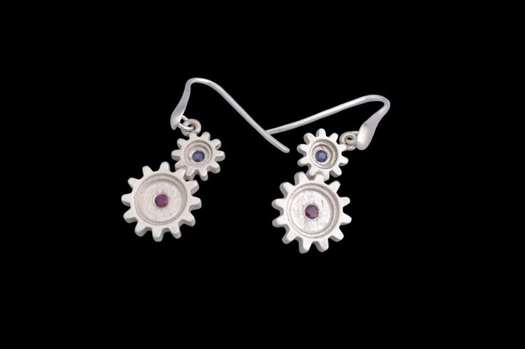 #silver #cogs #gears #earrings #ruby #sapphire #finejewellery #jewellery #preciousstones #gems #gemstones #industrial