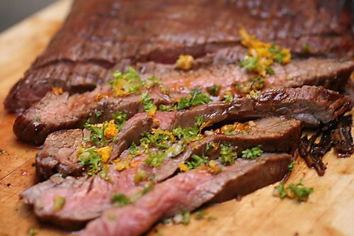 Flank Steak with Tamarind Glaze and Orange Gremolata (1/2 C coarsely chopped fresh ginger, 1/4 C honey, 1/4 C ketchup, 1/4 C tamarind concentrate, 2 chipotle chiles in adobo, stemmed and finely chopped, 3 garlic cloves: 2 smashed, 1 minced, 1 T apple cider vinegar, salt, pepper, 1/4 C finely chopped parsley leaves, 2 t grated orange zest, and one 1 3/4-lb flank steak)