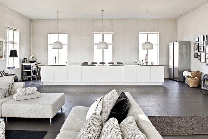 White and concrete kitchen / living area