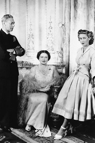 George VI with his wife, Queen Elizabeth and their youngest daughter, Princess Margaret.
