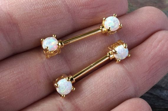 White opal prong set gold nipple bar barbell jewelry. 14 gauge nipple piercing, and barbell is 10mm long (not including opal ends), and 14kg plated