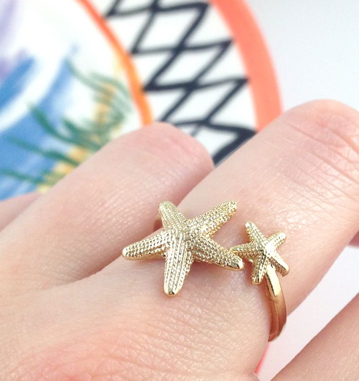 This+starfish+ring+is+simply+adorable+and+makes+the+perfect+accessory+to+any+summer+outfit.+Would+make+a+wonderful+gift+for+anyone+who+loves+the+beach+or+for+the+mermaid+in+your+life!  Available+in+gold.  Ring+size+fits+around+US+5-6.  *******See+something+else+you+like?*******  Shipping+...
