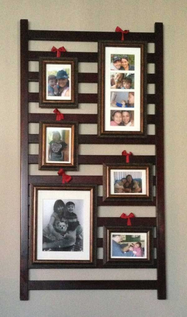 Repurpose+a+Drop+Side+Crib | 24.Hanging picture frames on an old crib rail!
