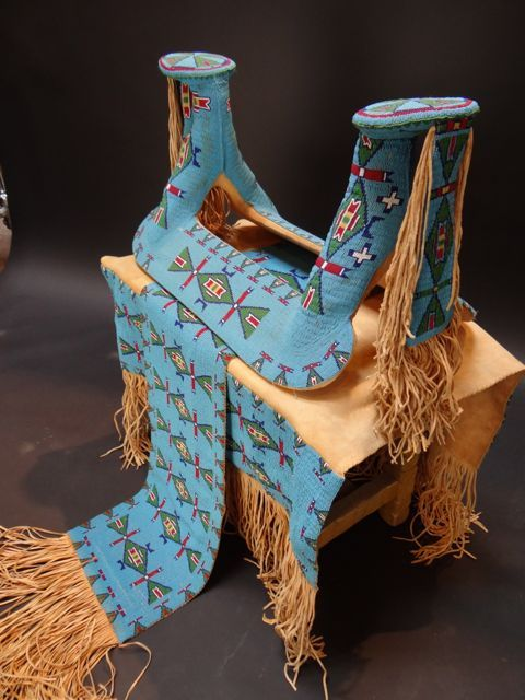 Cheyenne Beaded Saddle & Sash w Beaded Saddle Cover--A superb example of American Indian horse regalia. Circa 1960s. Glass beads sewn on with sinew thread. The beaded areas have approximately 254 beads per sq. inch.
