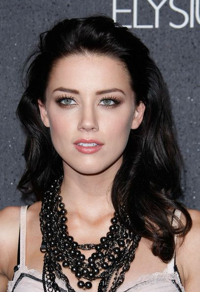 Amber Heard.... I can't decide if I like blonde or darkish on her.